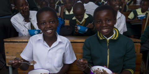 Lungisani Zondi (11) and Siyanda Shozi (12) enjoy breakfast at Jubilee Senior Primary School in Marianhill, 19 March 201