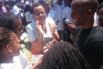 Mrs Graca Machel and Richard handing out sanitary protection in Mozambique (1024x576)