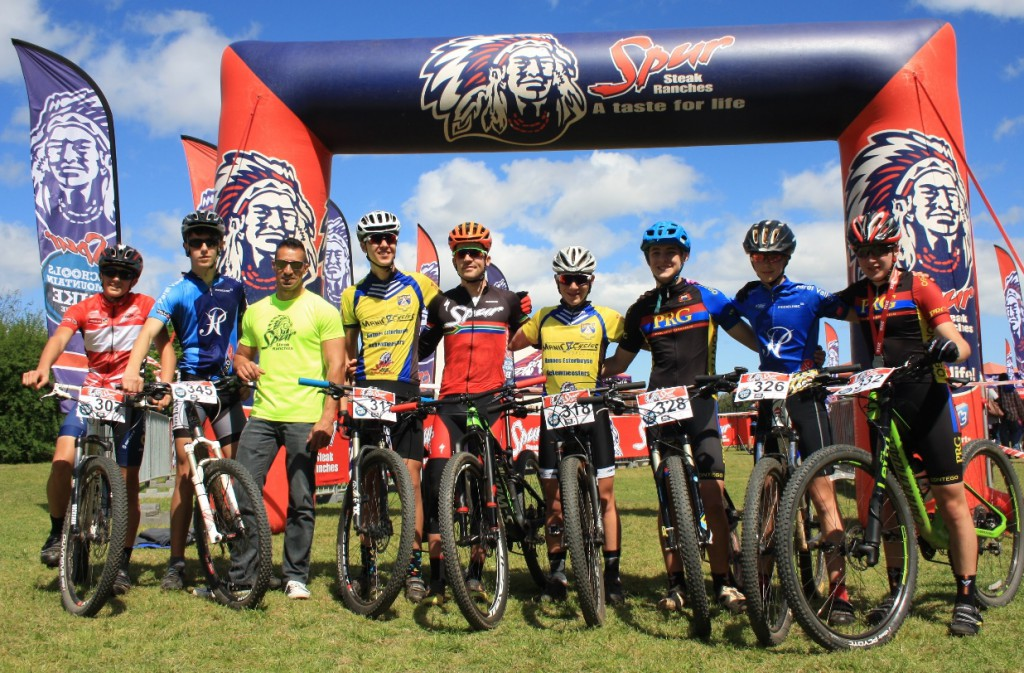 adam-dean-of-spur-and-james-reid-of-team-spur-with-riders-competing-in-the-western-cape-finals-of-the-spur-schools-mtb-league