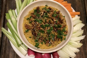 butternut squash and red onion dip with za'atar in a bowl surrounded by garnish