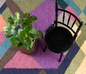 MOHAIR MAGIC UNDERFOOT A SPLASH OF 'LIVING CORAL' BRINGS ON-TREND RUG TO LIFE