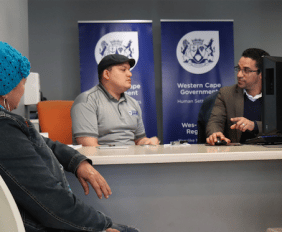 MINISTER SIMMERS SERVES CLIENTS AT HUMAN SETTLEMENTS HELPDESK