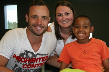 OSCAR PISTORIUS MEET WITH 12 YEAR OLD DOUBLE AMPUTEE, KUTLWANO MOTSWAI